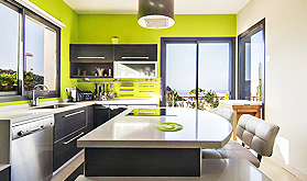Modern style kitchen with chrome appliances and lime green walls.